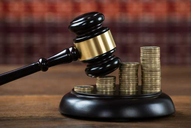 A Personal Injury Lawyers gavel hitting a stack of coins